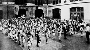 Schoolchildren in 1915 reciting the Pledge of Allegiance, accompanied by Bellamy's military salute, the same salute that would be adopted in the 1930s in Germany and Italy by Nazis and Fascists.