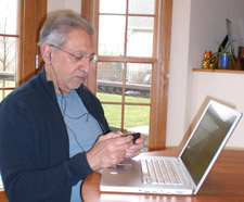 Too old to multitask? The author texting while writing on a laptop and listening to tunes