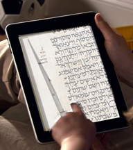 iTorah app showing Hebrew text on an iPad that can be paged from left to right