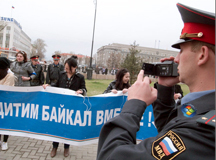 Russian police office taping a demonstration against the government's plan to reopen the Lake Baikal paper plant