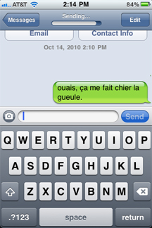 Photo of iPhone with potentially offensive text message, in French, which reads,