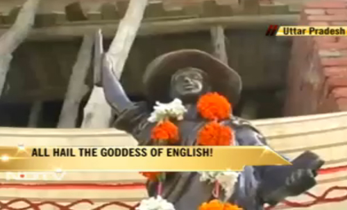 NDTV (New Delhi TV) reports on festivities at the Goddess English temple being constructed in the village of Bankagaon, UP. The three-foot high statue of the goddess, modeled on the Statue of Liberty, wears a floppy hat instead of a crown and carries the Indian Constitution in her left hand. Her right hand holds aloft a fountain pen instead of a torch. The statue's base is in the form of a personal computer.
