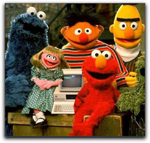 Sesame St. characters with an IBM computer