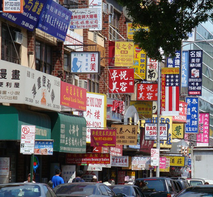 Flushing street lined with Asian shop signs