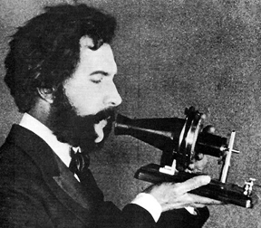 "Alexander Graham ""Ma"" Bell, demonstrates the proper way to use his invention"