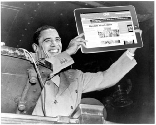 Pres. Obama holds up an iPad with CNN's erroneous report on the screen