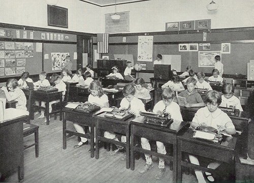 Children using typewriters in a 3rd-grade class