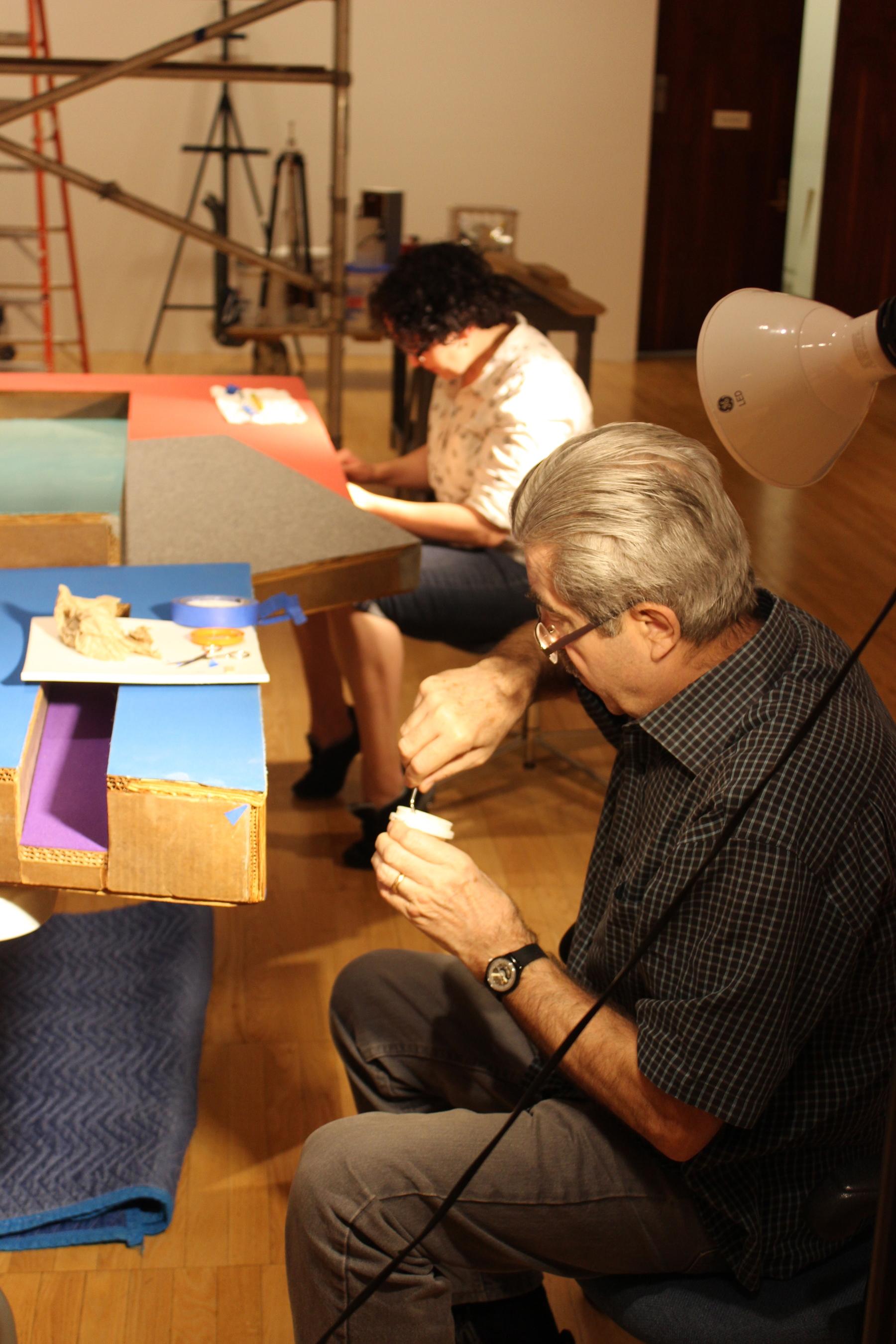 "Luca Bonetti and Beth Nunan work to conserve Frank Stella's ""Kosangrodek III"" in the East Gallery at Krannert Art Museum (June 2015)"