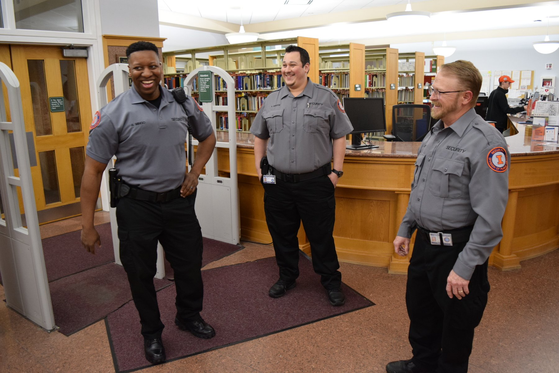 Security guards in gray provide highly-visible crime