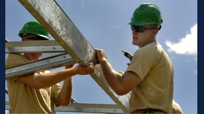 construction workers building structural framing. Image via Creative Commons