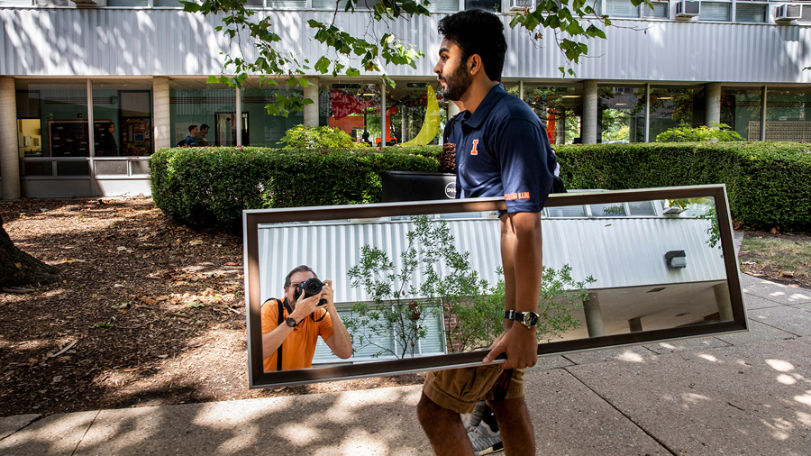 A wayward mirror catches University of Illinois photographer Fred Zwicky at work covering student move-in. Photo by Fred, of course.