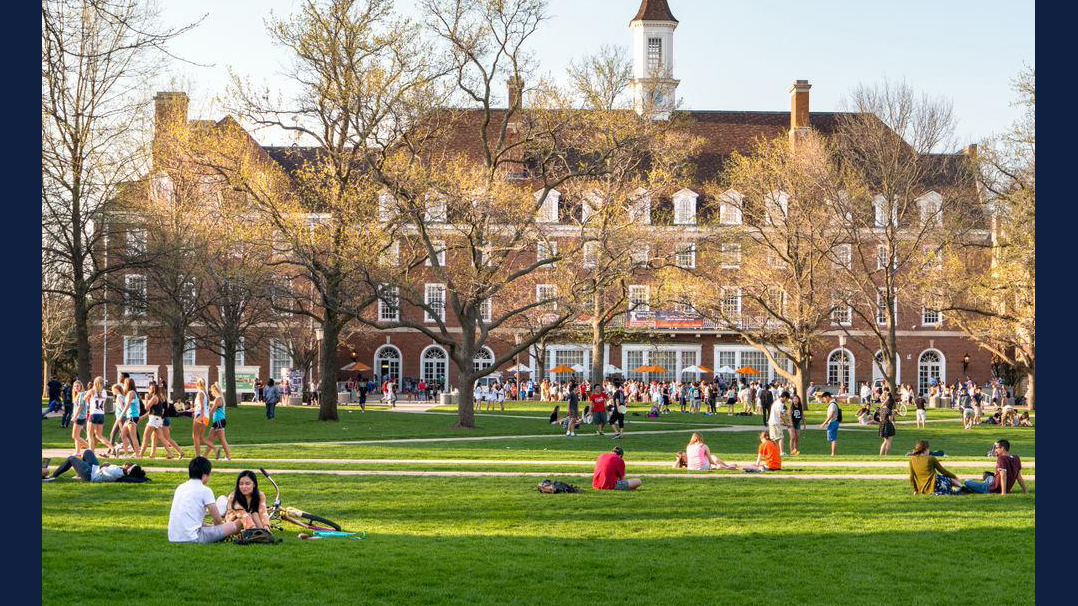 Students mingle on the Quad of the University of Illinois college campus in Urbana-Champaign in 2011.  Leigh Trail | Shutterstock.com