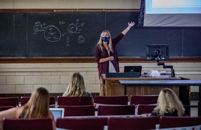Professor Allison Vance teaches in a mask and with students dispersed to safe distances. Photo by Fred