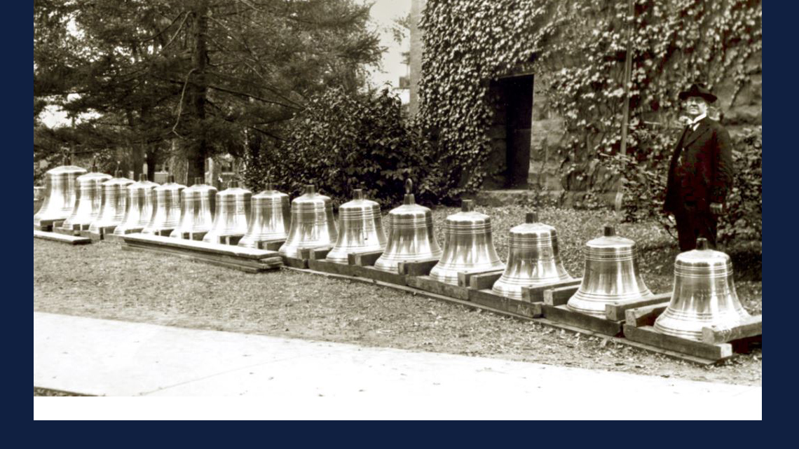 archive image of University President Edmund Janes James (1855–1925) posing next to the soon-to-be-installed chime bells