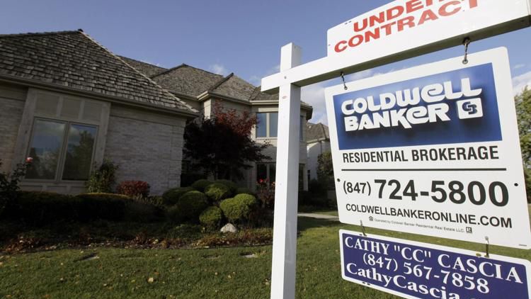 In this Wednesday, Oct. 10, 2012, photo, an under contract sign sits outside a home in Glen, Ill.   AP Photo/Nam Y. Huh