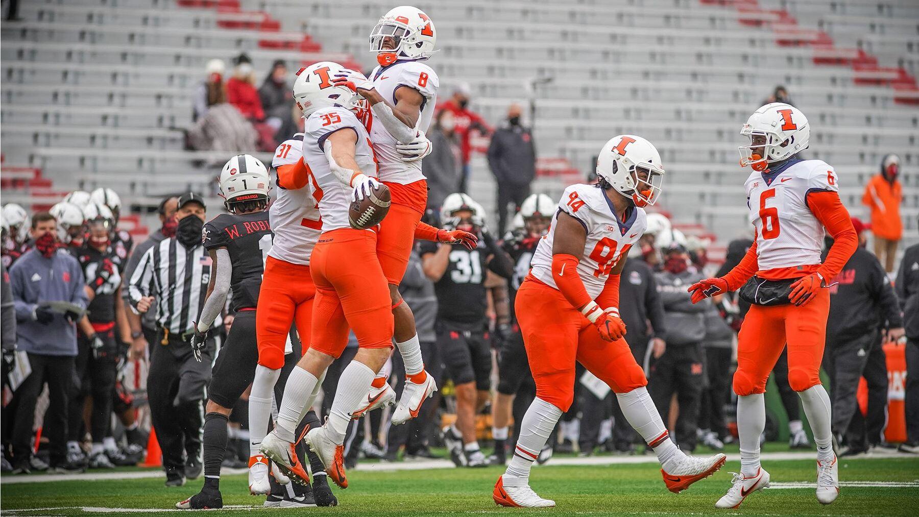 players celebrating on field in Nebraska
