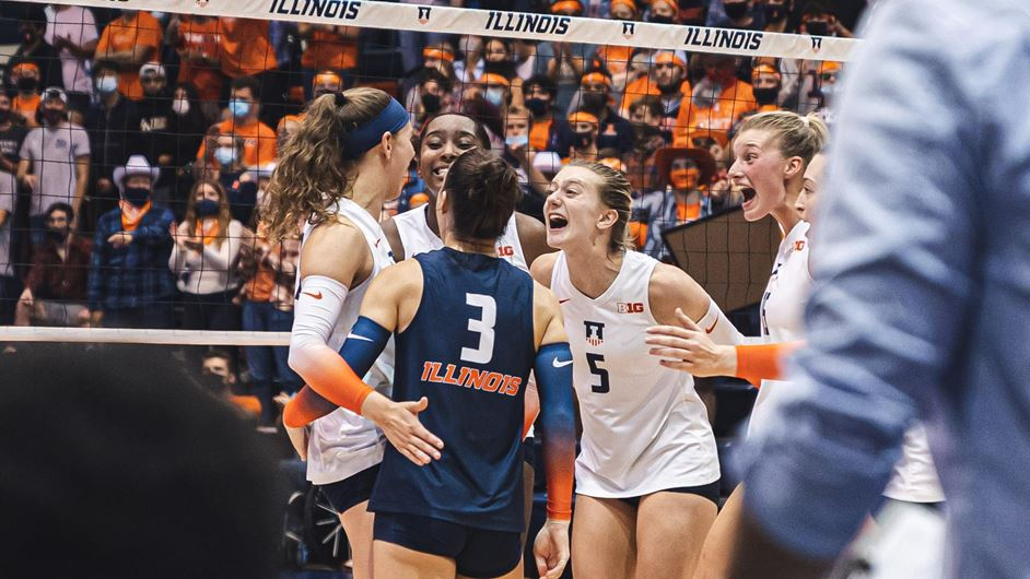 Illini setter Diana Brown central in a photo of team's on-court celebration