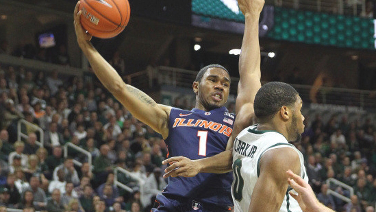 image of illini player jaylon tate going over a spartan defender