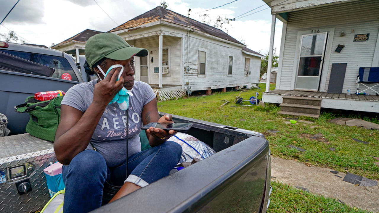 Linda Smoot, a resident of Lake Charles, Louisiana, returned from a shelter after Hurricane Laura in August to find storm damage at her niece's home. AP PHOTO/GERALD HERBERT