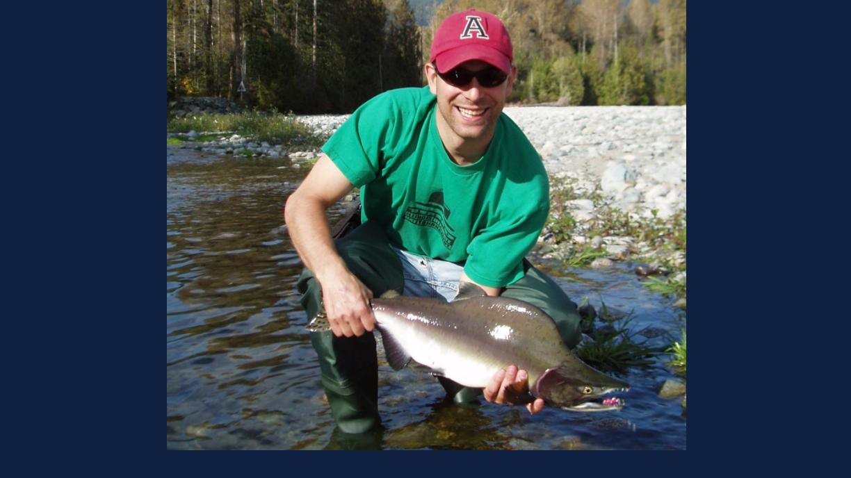 Researcher Cory Suski holding a salmon