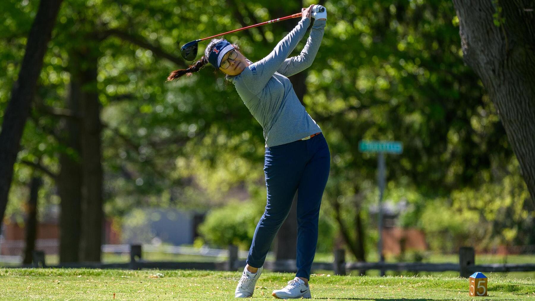 Junior golfer Chrystal Wang tees off