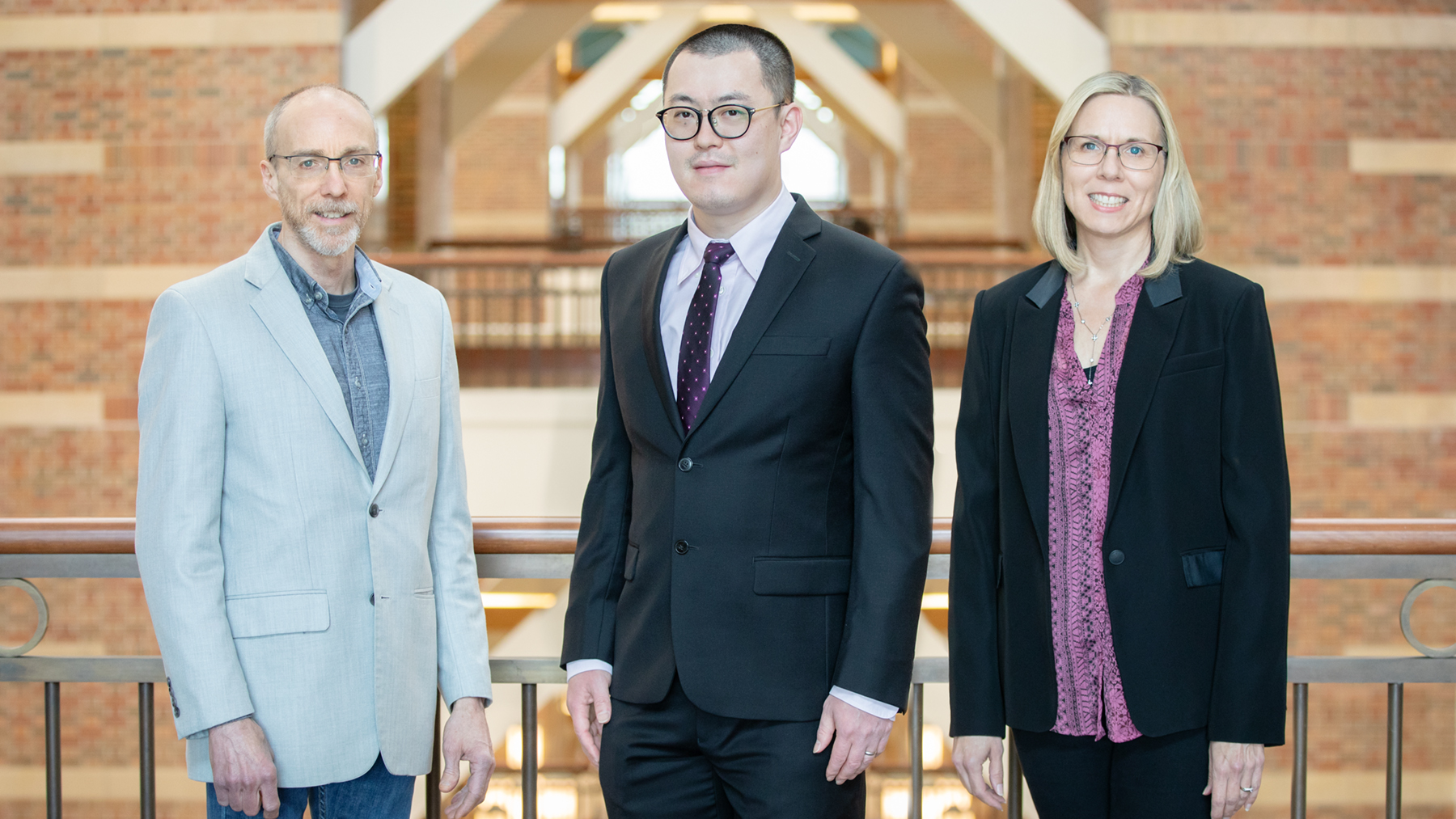 Beckman Institute director Jeffrey Moore, left, postdoctoral researcher Hai Qian and materials science and engineering head Nancy Sottos. Photos by L.B. Stauffer