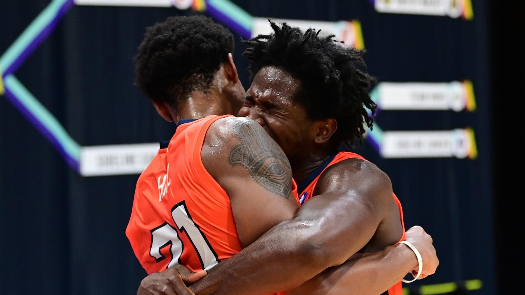 Andres Feliz and Malcolm Hill embrace after the victory.