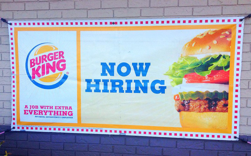Burger King 'now hiring' sign. Photo via Flickr by Mike Mozart