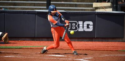 an Illini player's swing capture just before she connects with the ball