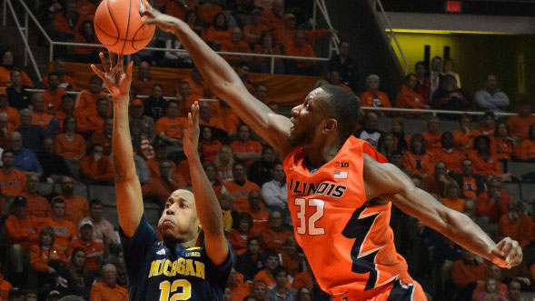 image of illini center nnanna egwu blocking a basketball shot