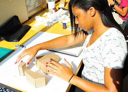 Gabrielle Benjamin, of Orlando, Florida, works on a structure she is designing during studio time in the 2014 Discover Architecture program.