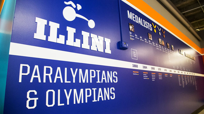 Image of the renovated training facility featuring a wall listing all of the U. of I. Paralympians and the medals theyve won.