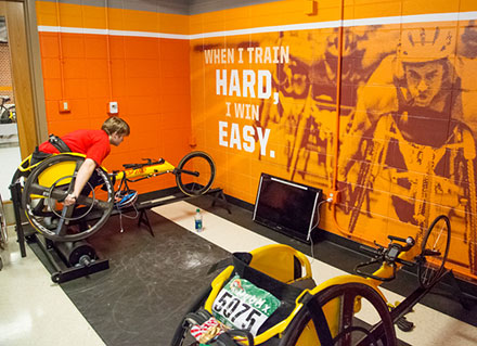 image showing a new paint job and photographs and motivational slogans on the walls of the paralympic training facility.
