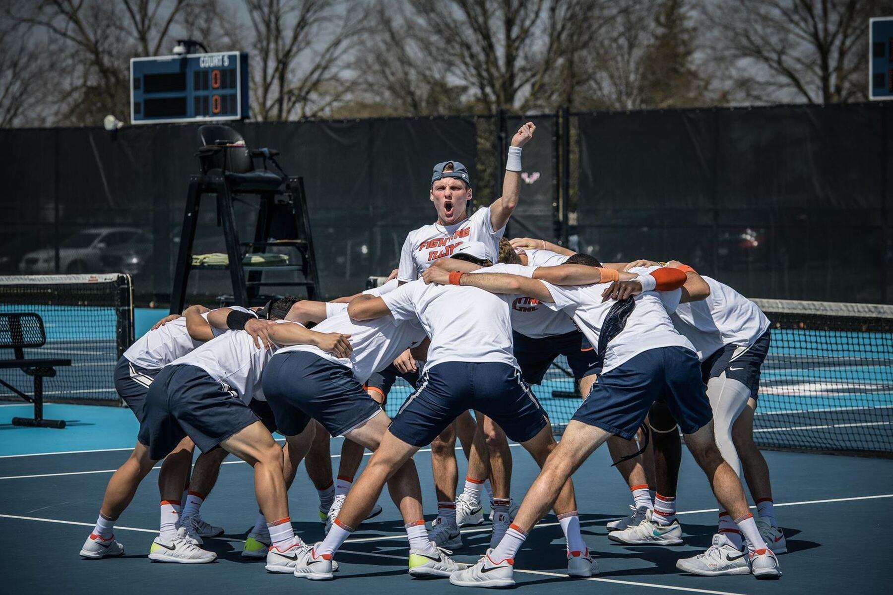 Men's tennis team huddles on court