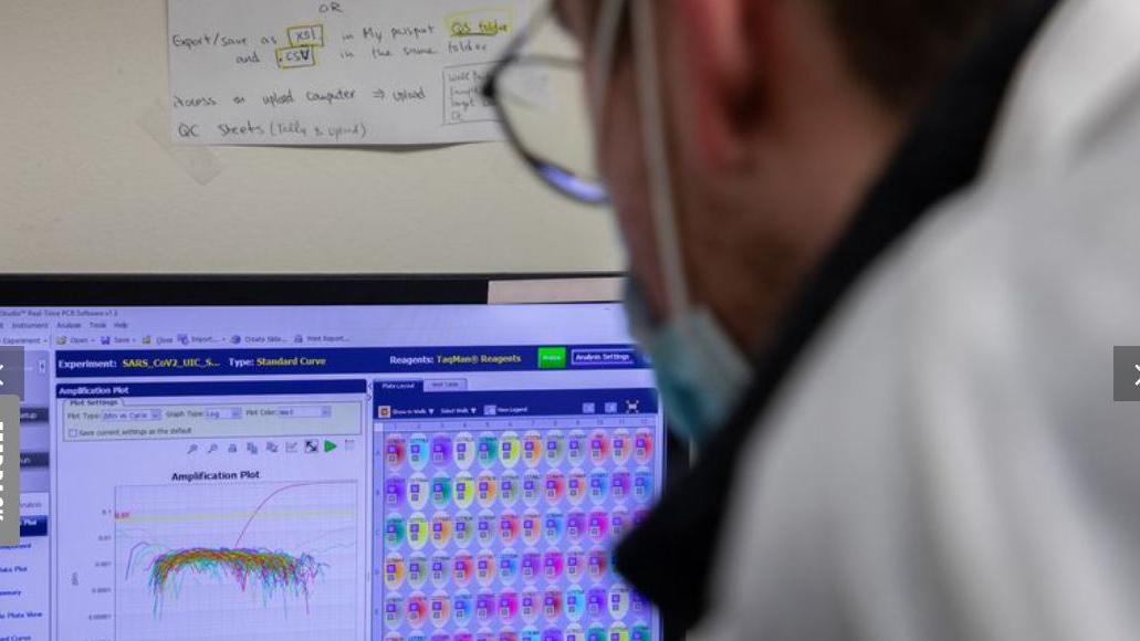 technologist monitors COVID testing equipment at the UIC Hospital. Photo by Zbigniew Bzdak / Chicago Tribune