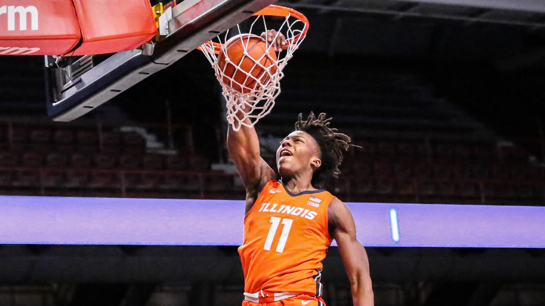 Ayo Dosunmu alone at the rim as basket scores