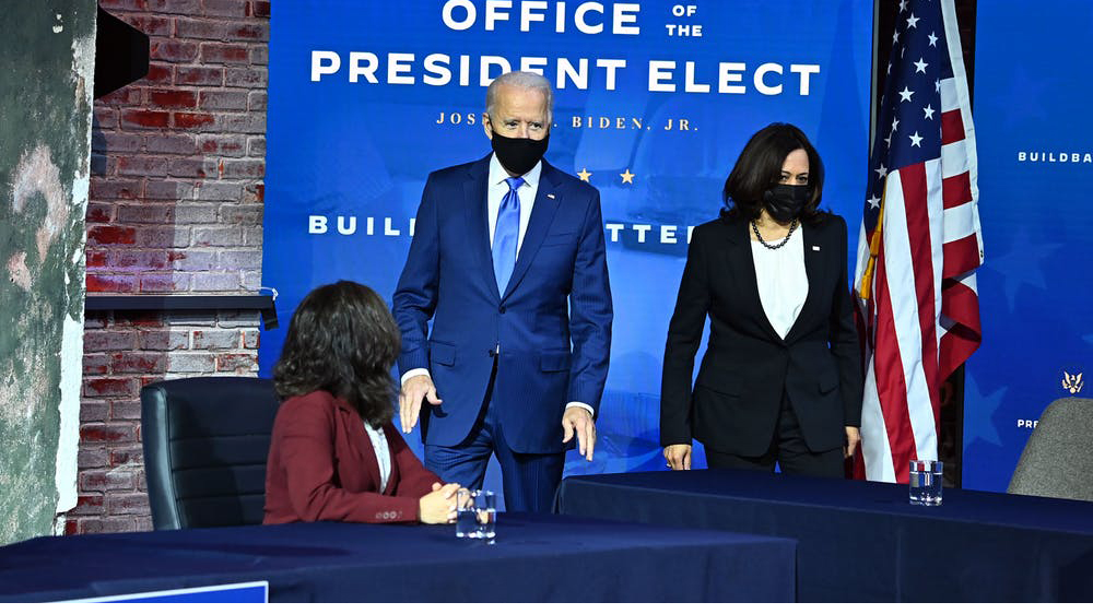 Biden and Vice President-Elect Kamala Harris appear jointly at an event. Chandan Khanna/AFP via Getty Images