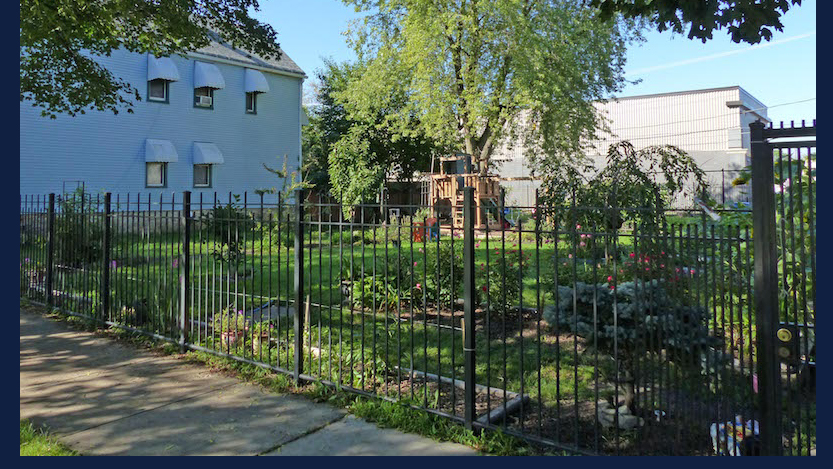 a formerly vacant city lot has been turned into a lovely greens space, play area