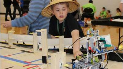 image of youth with robot under construction