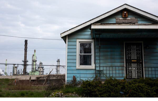 A home near the Marathon Petroleum Company refinery in River Rouge, near Detroit.Credit...Emily Rose Bennett for The New York Times