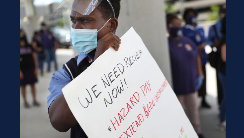 Protester for increased wages during the pandemic. Photo by Joe Raedle for Getty Images