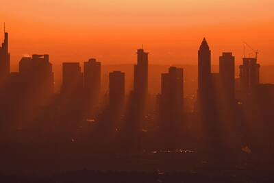 hot and hazy city at sunset. PHOTOGRAPH: ARNE DEDERT/PICTURE ALLIANCE/GETTY IMAGES