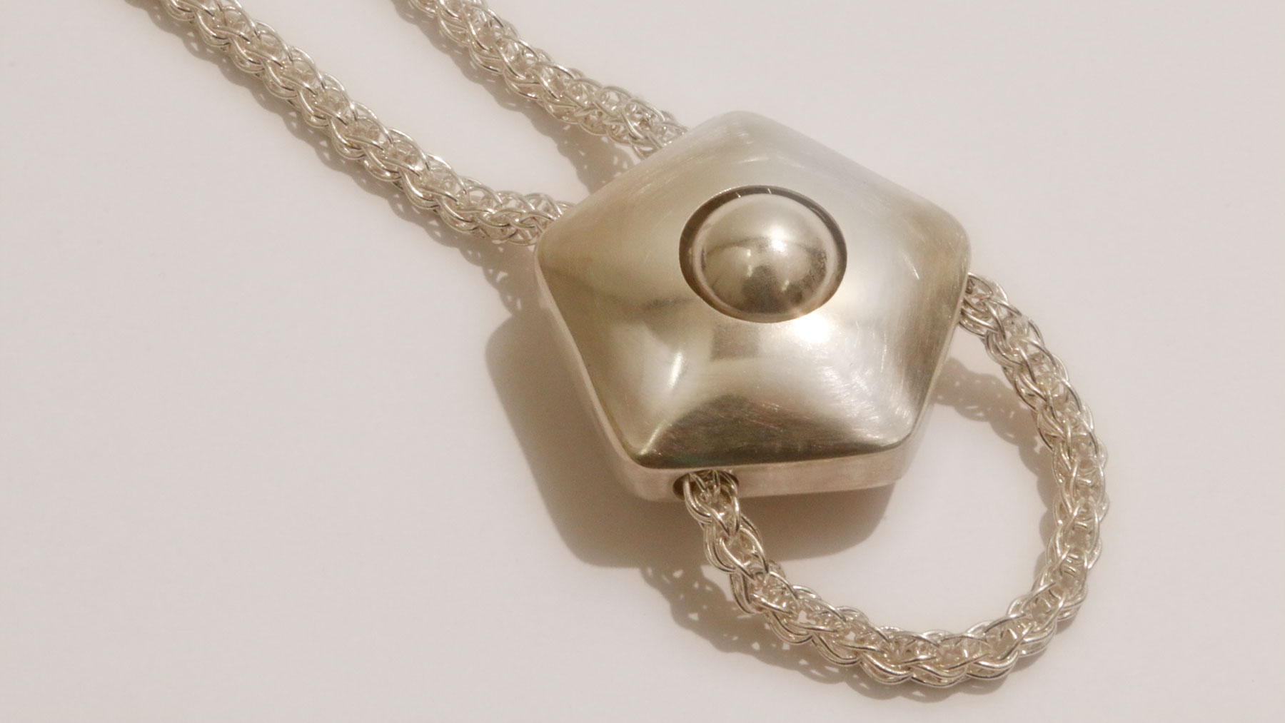 Image of silver Restraint Necklace, 2015, by BFA Candidate in Metals Weija Wang.