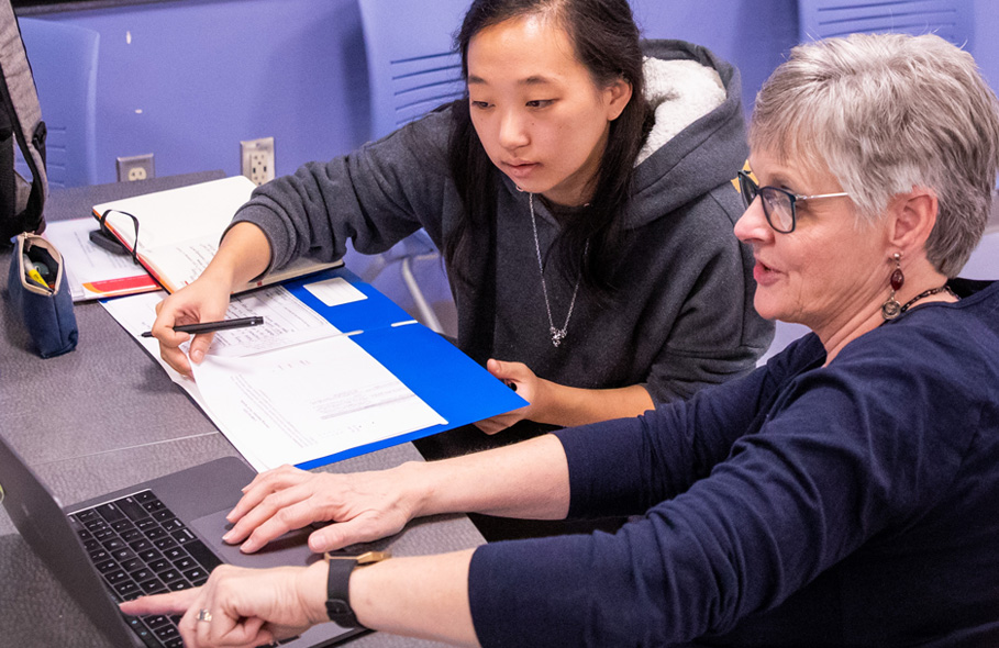 Lynn Burdick works with a new teacher