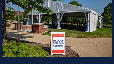 a tent set up on the U of I campus for COVID-19 testing. Photo by Fred Zwicky