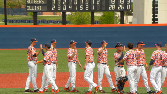 Illini baseball players high five each other after win