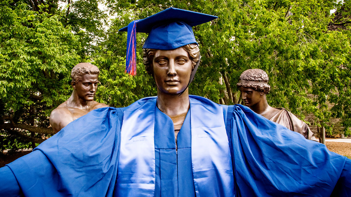image of alma mater statue wearing commencement regalia