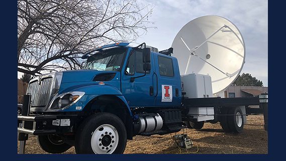C-band on wheels mobile radar. The white parabolic dish is the radar antenna used to transmit and receive microwave signals. The antenna, and truck bed, are stabilized and leveled using the hydraulic feet. (Photo courtesy of the Department of Atmospheric Sciences.)