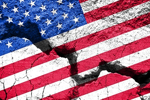 American flag painted on cracked concrete. Stock image.