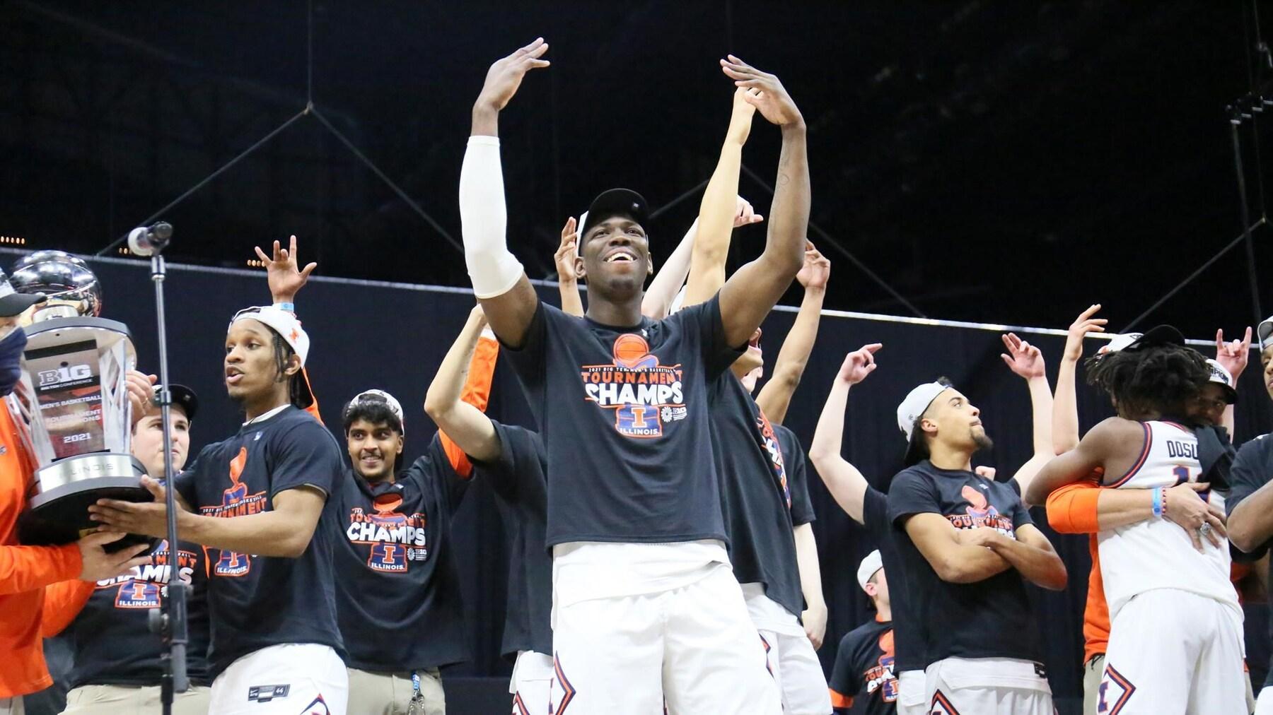 Kofi Cockburn wearing a Big Ten Tournament championship tee shirt, celebrating with teammates